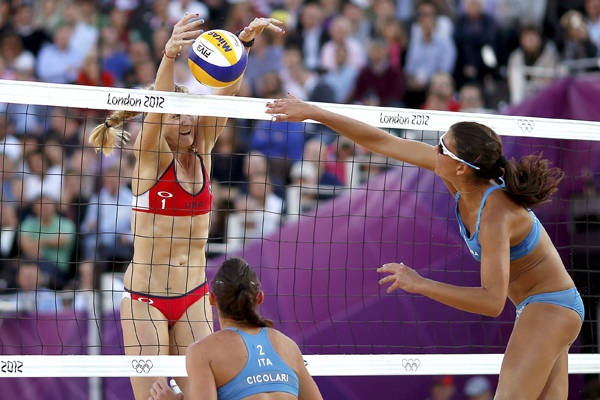 Oh, no you don't - Kerri Walsh of the United States blocks against Italy's Marta Menegatti during Sunday's victory by the Americans.