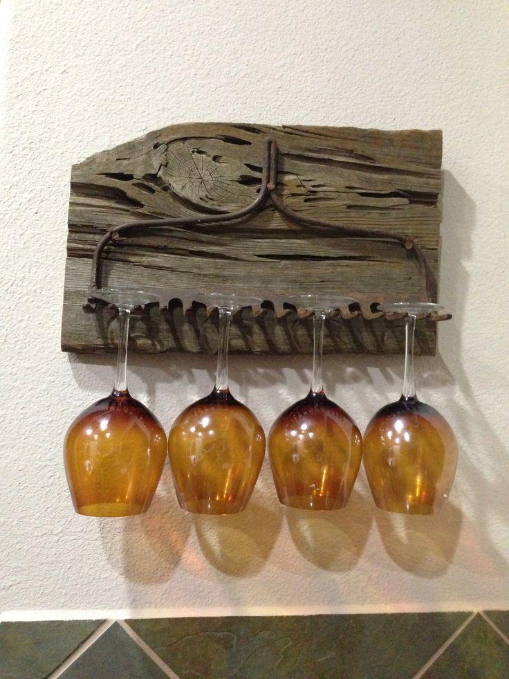 Hand-made wine glass rack. Petrified wood from hurricane Katrina and antique rake.