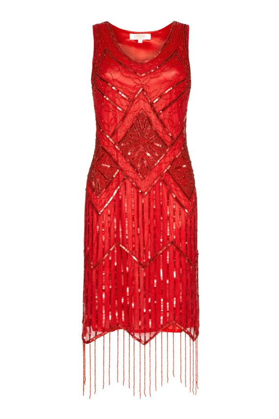 Inspiré par le glamour de lépoque de Great Gatsby des années 1920. Cette robe de frange de clapet noir doux met en valeur une conception complexe et mousseux à la main-agrémentée. Vous êtes lincarnation de lélégance intemporelle de la soirée dans cette robe doublée, sans manche. Avec son superbe ourlet de frange, elle comprend vintage glamour des années 1920 et est garanti pour créer une impression durable. Noubliez pas de compléter votre look de Gatsby le magnifique avec le bandeau assorti…