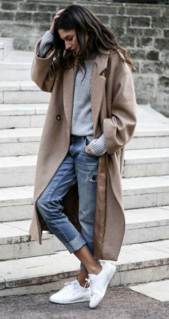 effortless city style + over-sized taupe trench + distressed boyfriend stylejeans + white sneakers + Casual tousled hair + low-key and approachable look + Federica L.  Coat: H&M, Sweater & Shoes: Missguided, Jeans: Zara, Rings: Lily's Creations, Cross Model, Be Maad, Thomas Sabo, Earrings: Lily's Creations