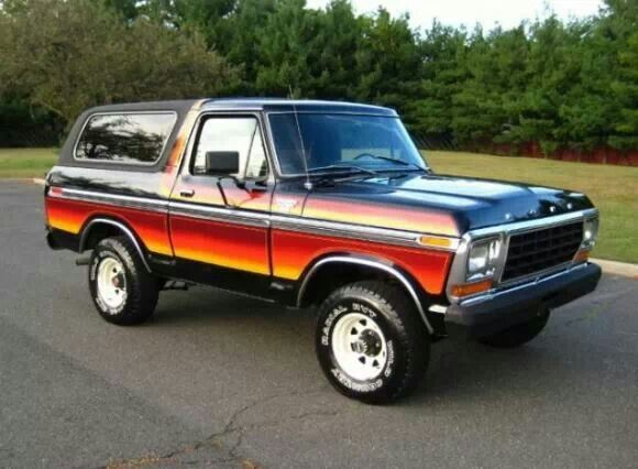 1978 bronco with multi colored stripes and white spoked wheels rh pinterest com