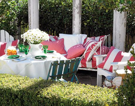 A Cozy Patio: The house's original limestone patio is surrounded by a low boxwood hedge.