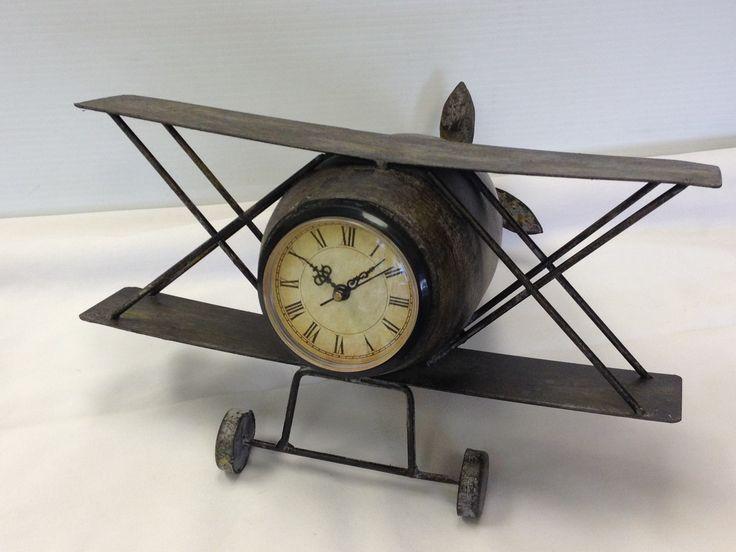 Loving this little bi-plane clock