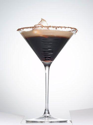 Espresso Martini - Shot of espresso - 1/2 oz. Three Olives Chocolate Vodka - 1/2 oz. Godiva dark chocolate liqueur - 1/4 oz. Amaretto -  1/4 oz. Kahlúa - Baileys to top off