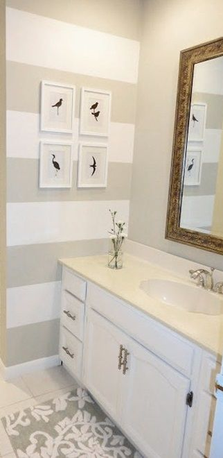Striped accent wall and rug matching colors Do something like this in the small bathroom