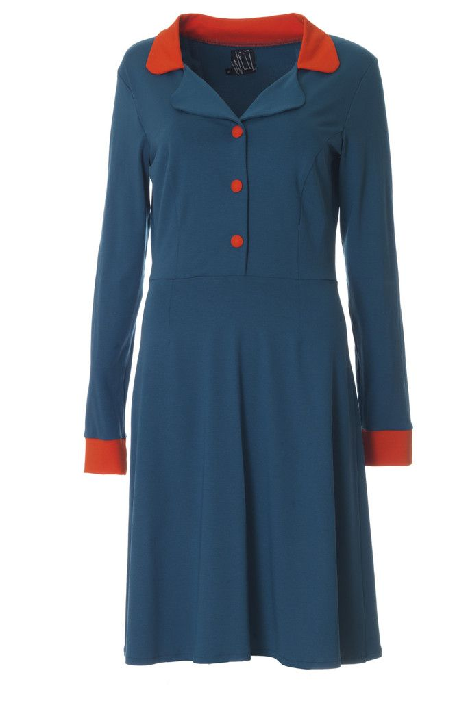 This petrol and orange retro inspired dress has a perfect fit for the fall. Made of soft jersey with covered press buttons.