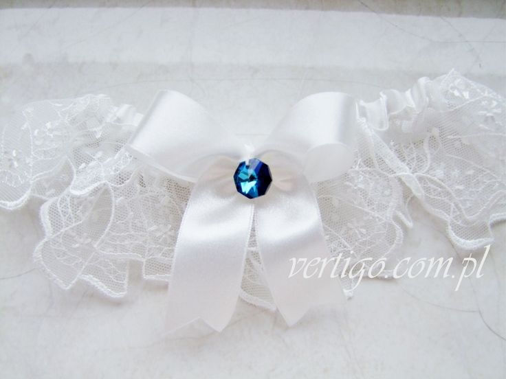 handmade garter with lace and blue crystal, source: http://www.vertigo.com.pl/projekty/podwiazki/#prettyphoto[gallery]/1/