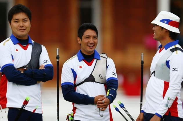 Hideki Kikuchi, Yu Ishizu and Takaharu Furukawa of Japan in look on in the men's Team Archery Eliminations match between Japan and India on Day 1 of the London 2012 Olympic Games at Lord's Cricket Ground on July 28, 2012 in London, England.