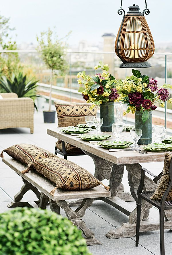 This impressive, heavy wooden dining table by OKA is made from solid pine and sealed with resin to make it suitable for outdoor use. An ideal table for terraces, patios and small gardens.