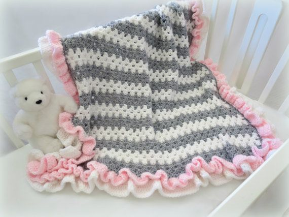 Crochet baby blanket pattern with cute stripes and ruffles. Adorable, fast and easy to make with a basic granny stitch #crochet ♥ Pattern by Deborah O'Leary Patterns