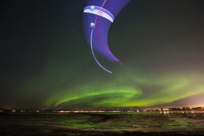 Bucketlist! Stunning images capture paraglider's 'dance' with Aurora Borealis.