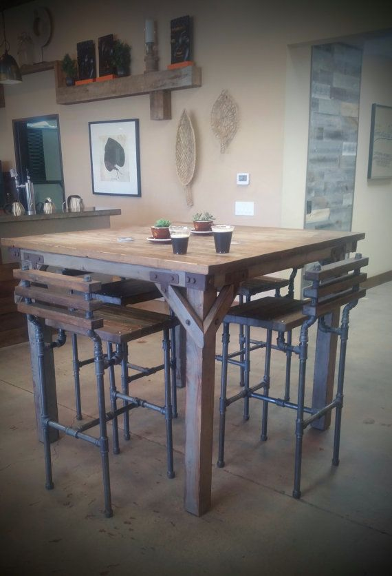 Our Bodhi Pub table is handmade and features an artistic industrial rustic chic style. This one is featured with gray legs; however, legs and top stains can be customized. Bar stools are purchased separately.  Would look awesome anywhere... home, cafe, brewery.  MEASUREMENTS: -Top: 52 x 52 -Height: 43  SHIPPING: Shipping may vary depending on area and the number of items. Shipping discount on multiple items. Please feel free to leave us a message if you have any questions.  PLEASE CONTACT US…