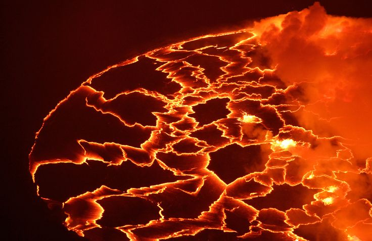 Magma churns and gushes in the lava lake of Mount Nyiragongo, one of Africa's most active volcanoes, in Goma, Congo on March 31, 2010. (AP Photo/Rebecca Blackwell)