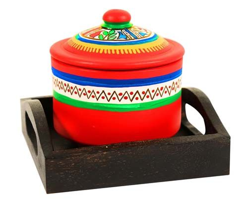Terracotta Hand painted Warli jar with Ethnic Wooden Tray.   Gives a classy and peppy feel to your table décor.