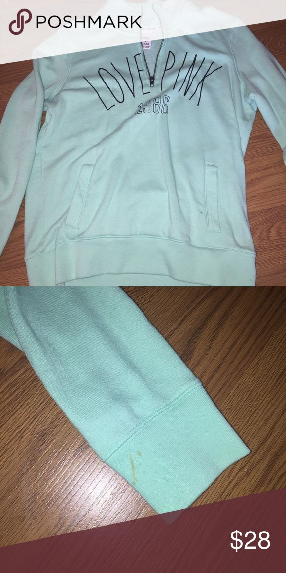 Women's pink zip up Mint in color . Worn once has a stain on sleeve as shown . Pink zip up PINK Victoria's Secret Sweaters