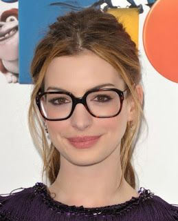 Hairstyle ideas for eyeglass wearers.  Anne Hathaway is effortlessly chic in a classic ponytail with big-rimmed glasses.