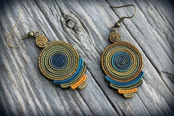 I made this earrings wrap them with polymer clay with fine and detail work using no mold at all giving an ethnic bohemian look! The whole earrings