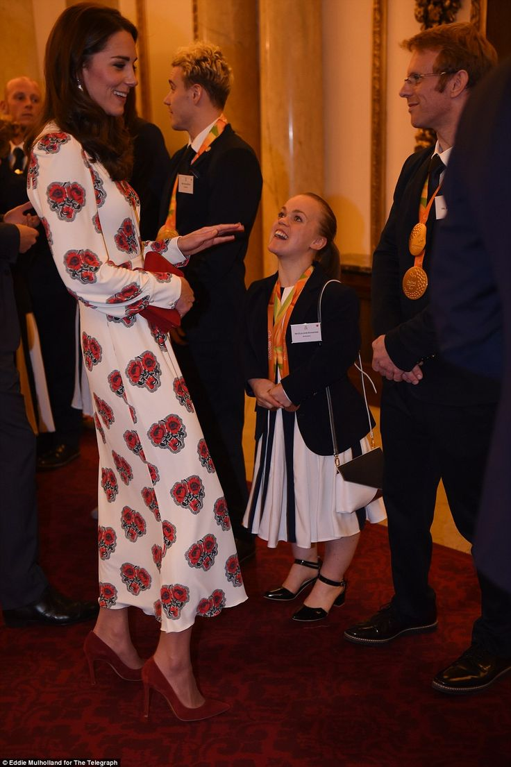 Kate opted for the poppy-adorned gown at the reception to honour Olympic and Paralympic heroes, pictured with champion swimmer Ellie Simmonds