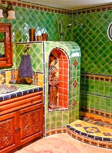 Bathroom using Mexican tiles. green blue orange red! i love that there is no door! perfect and beautiful shower!