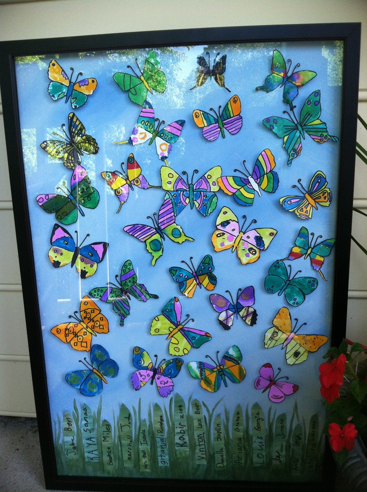 """Ready for the auction tomorrow!  mini lesson on symmetry/kids decorated a butterfly shape with black sharpie in symmetrical designs, then watercolor. I added their handwritten names as the grass. Used """"memory thread"""" for antennas. glue-dotted the butterflies on water colored canvas and shadow box framed."""