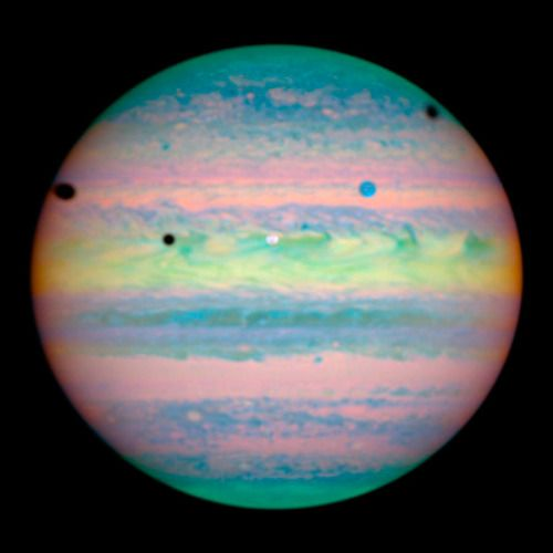Triple eclipse! NASA's Hubble Space Telescope reveals spots on Jupiter are actually a rare alignment of three of Jupiter's largest moons – Io, Ganymede, and Callisto – across the planet's face. This image was taken March 28, 2004, with Hubble's Near...