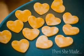 Use cookie cutters to cut cheese.  Then you could add them to raw fruit, veggie, or olive kebabs.