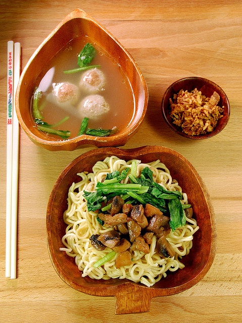 Mie ayam (This another variation of noodle dish is served with chicken broth soup. It is usually topped with sweet seasoned chicken, scallion, kai choy, and dumplings.)