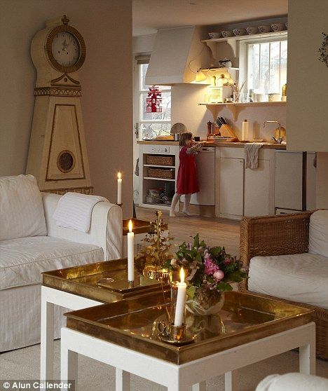 Interiors Clare Nolan From homespun decorations to glimmering candlelight, Danish designer Jette Frölich (right) fills her home with subtle sparkle