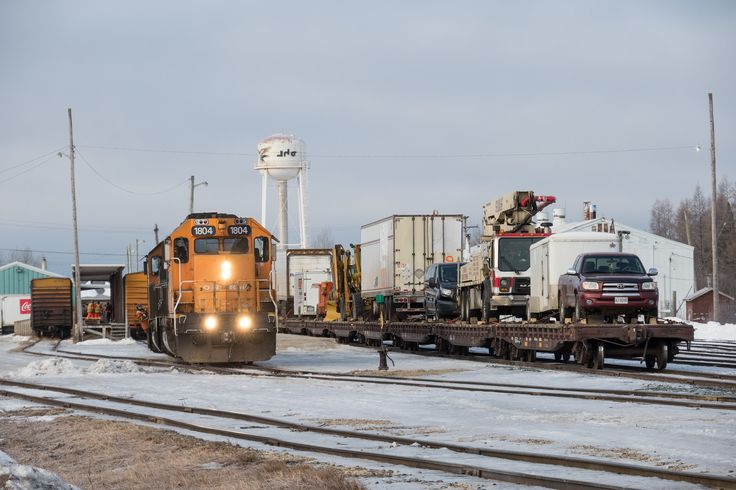 Locomotives pulling out of freight platform track in Moosonee. Freight 419.