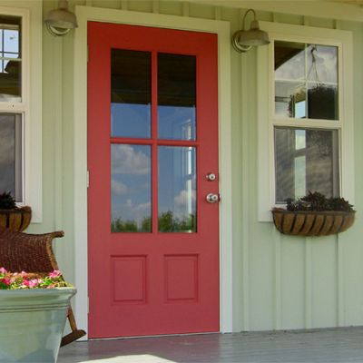 Board and Batten: A welcoming, country style entry is seen in this tiny house with green-painted board and batten, along with proportional door and windows. http://www.kangaroomsystems.com/kanga-room-gallery/kanga-studio-country-cottage-12-x-14/5969202
