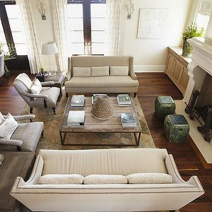 Neutral sofas facing each other fireplace stools of some - Brickmakers coffee table living room ...