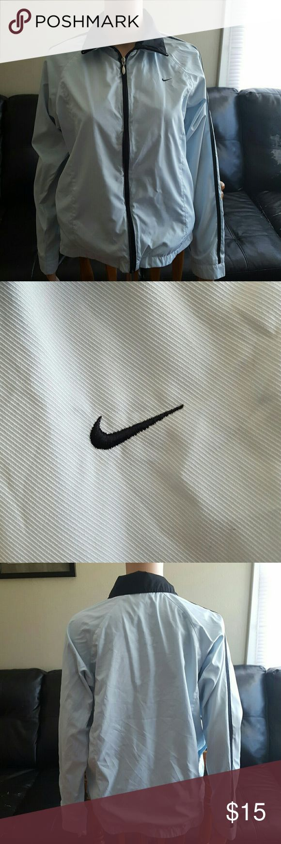 Nike baby blue and black lined windbreaker jacket This cute jacket is pre-owned and does have signs of wear.   There is no rips holes or stains and it is in good  pre-owned condition.  Thanks for looking Nike Jackets & Coats