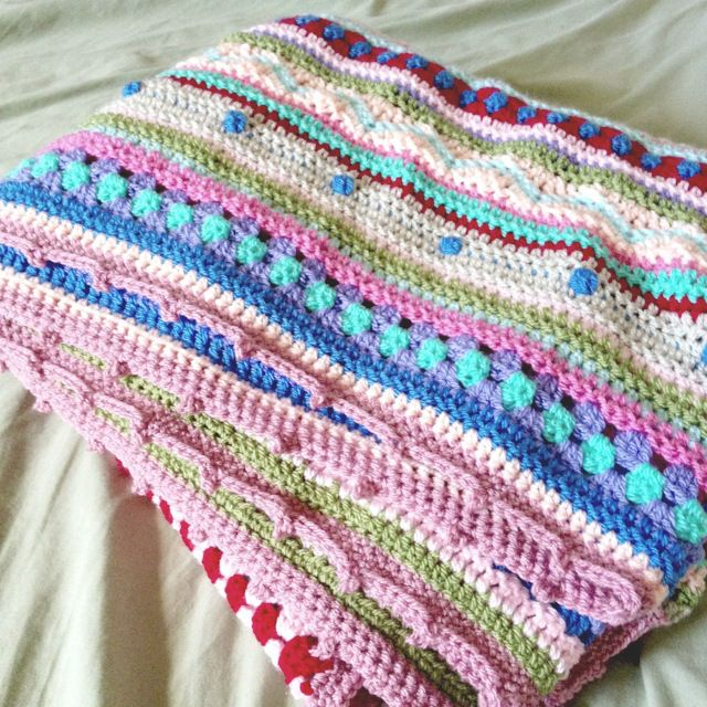 A free pattern from www.notyouraveragecrochet.com as we go stripey blanket
