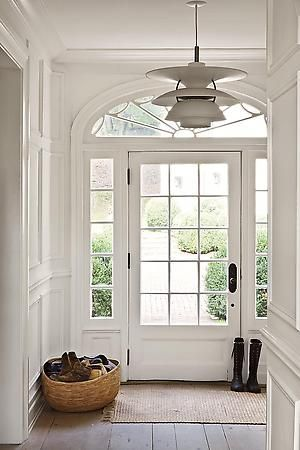 Simple hallway/entrance with large front door idea with windows to the side and above