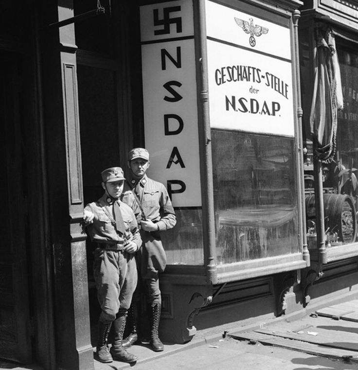 Two American Nazis in uniform stand in the doorway of the party's New York City business office on the day it opened (April 1, 1932).