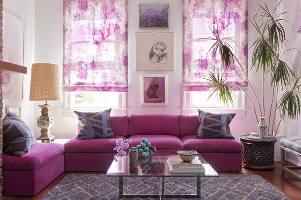 Angie Hranowsky Photo - A pink couch and a glass-topped coffee table in a vibrant living room