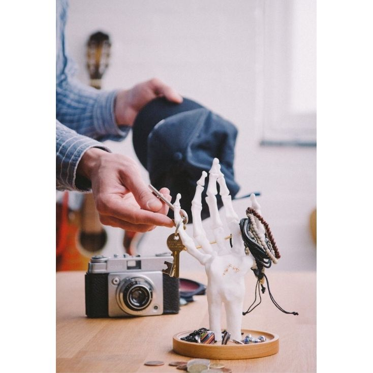 Keep your jewellery in the palm of your hand - well, your skeletal palm anyway! Smither's Skeleton Jewellery Tidy takes care of your most prised possessions - fingers will keep rings, bracelets and earrings organised neatly. Too many trinkets to wear all at once? Display them tidily on these stylish storage bony fingers. The metal joints move independently so you can pose the hand to best show off your gold and silver treasures. And if you have even more jewellery than the A Team's Mr T,