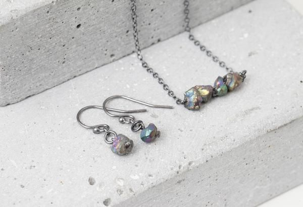 Gemstone earrings in oxidized sterling silver with small rainbow pyrite gemstones.  Made in Oslo, Norway