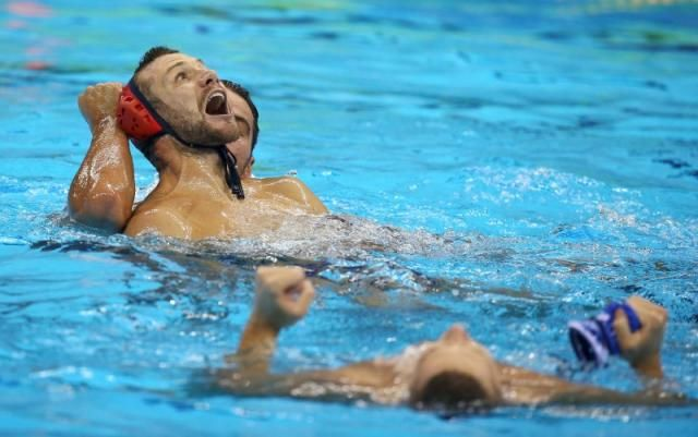 2016 Rio Olympics - Water Polo - Final - Men's Gold Medal Match Croatia v Serbia - Olympic Aquatics Stadium - Rio de Janeiro, Brazil - 20/08/2016. Members of the Serbia team celebrate their gold medal win.    REUTERS/Damir Sagolj