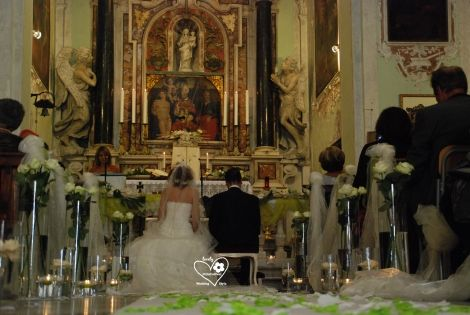 the bride and groom at the altar