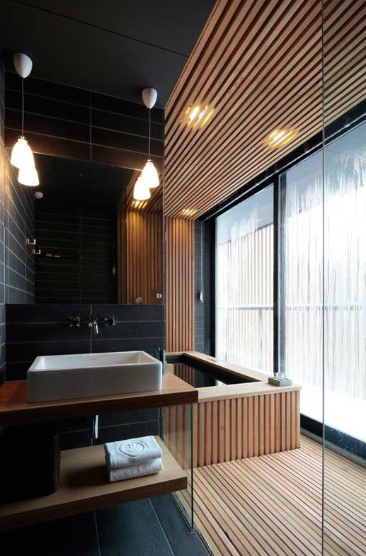 Another good example of a sensual bathing area. Luc builds a Kin style bath for Rah, which is very like a Japanese bathing room. Wood slats, resting pool, places to lounge. Bathroom / Atelier BNK
