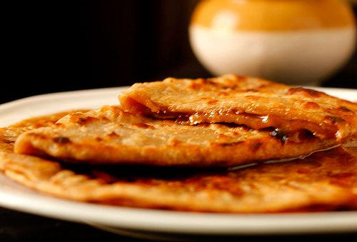 Busri is a traditional Sindhi roti made with atta (whole wheat flour) and stuffed with gurr (jaggery). www.desiappetite.com