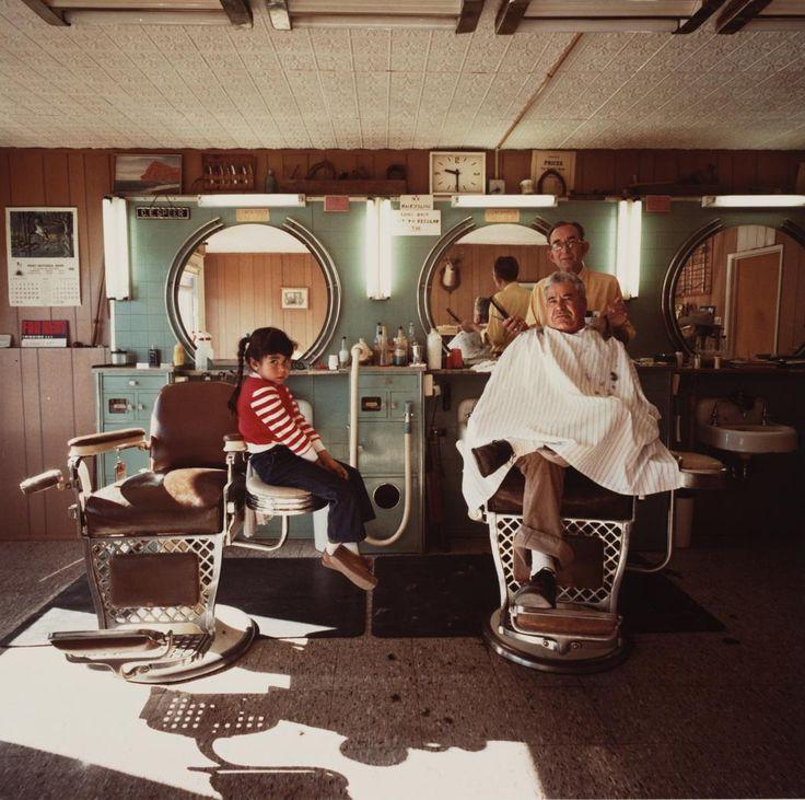 Louis Carlos Bernal 1941 - 1993 Leon Speer's Barber Shop, Felix Valdivezo & Daughter Patricia, Lordsburg, New Mexico Date: 1978