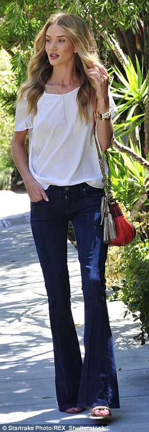 Model Rosie Huntington-Whiteley, 28, picked a pair of dark blue denim flares for a casual day look