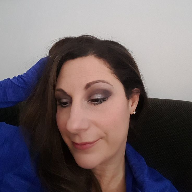 smokey eye with a hint of white on eye lids.  elegant yet sexy.  click on image