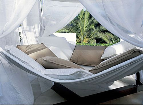 The giant hammock that comes with a canopy. | 30 Impossibly Cozy Pieces Of Furniture You Could Die Happy In