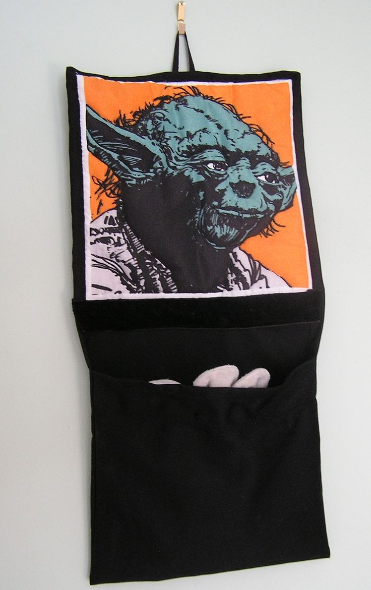 This quilted star wars character wall-hanging was requested by my son and has a pocket at the bottom for storage.