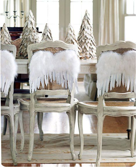 Love these white paper christmas trees and angel wings on chairs