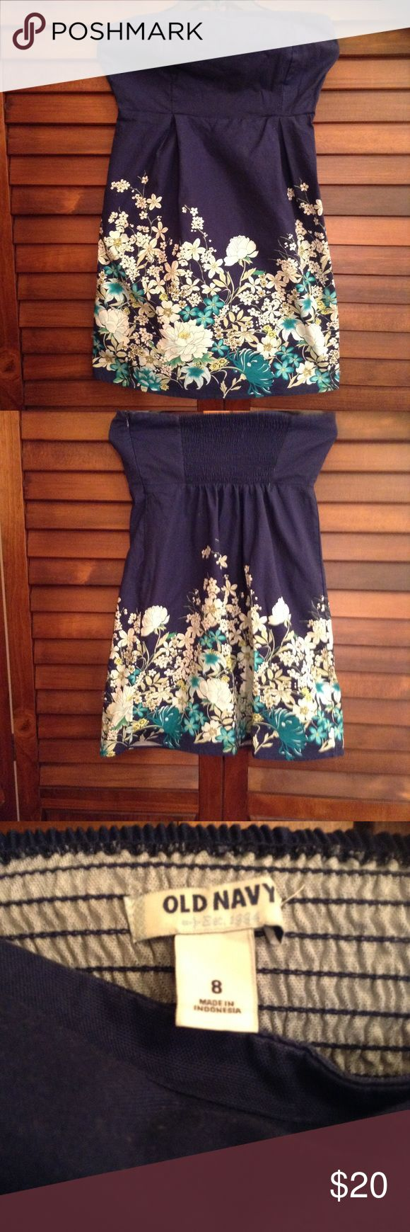 Cute Navy Blue, With Flowers Strapless Dress Cute dress can be worn to any occasion, dress is strapless, with pretty yellow white and green flowers on lower part of dress, stretch on upper back of dress Old Navy Dresses Strapless