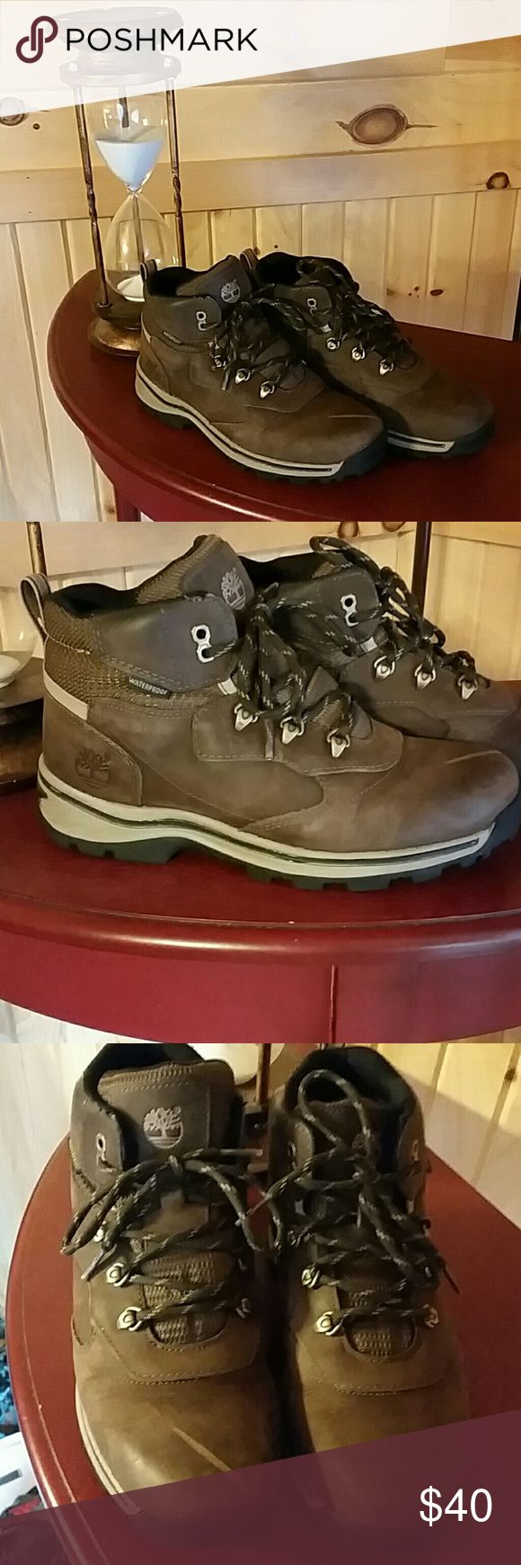 Timberland Youth Boots Size 5.5Y /7 Women A gently preloved pair of Timberland Boots A  Hiker Style without their box. The right shoe had a large scratch that is visible in my photo. Priced to moved..Purchased last year... Timberland Shoes Winter & Rain Boots